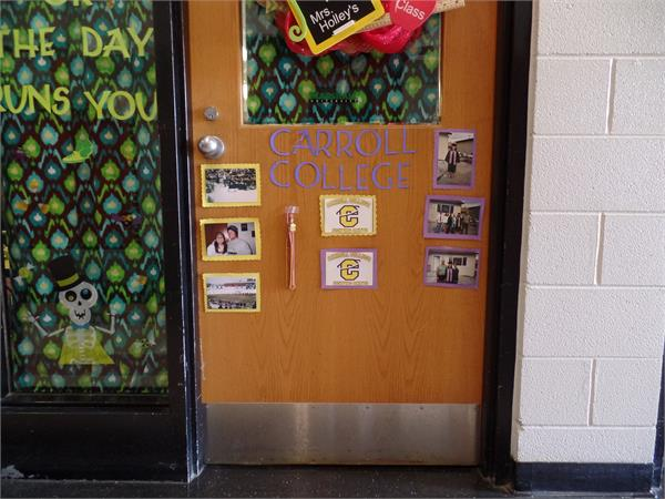 College Decorations - teacher decorate their doors in the colors of the college from which they graduated.