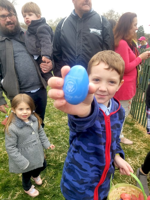 Sebastian Vance holds up the unique wooden egg he found during the White House Easter Egg Roll activities.