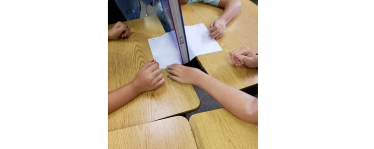 Third grade Ponderosa students had their #NGSS thinking caps on while trying to suspend the weight of a book with a piece of paper.