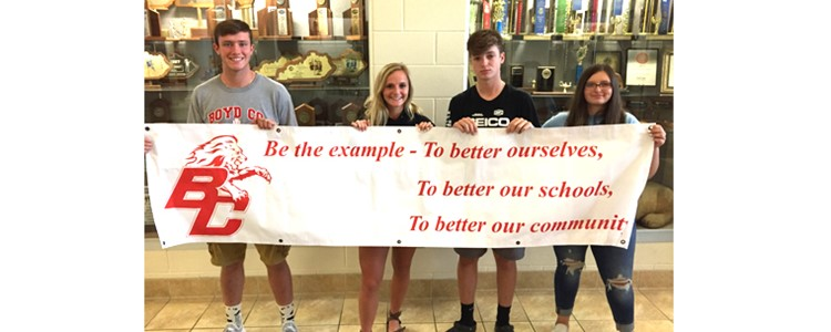 BCHS Students, Alex Lee, Lexi Marcum, Dylan Stanley, and Chasity Moore unveiling our new mission statement #BETHE EXAMPLE