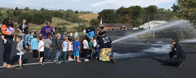 Learning to spray the fire hose.