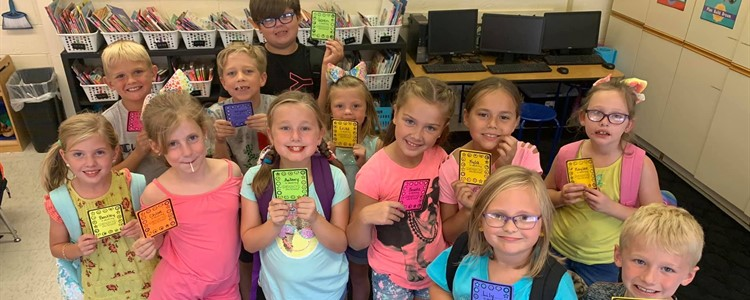 Mrs. Salyers' 2nd Graders showing off their punch cards!