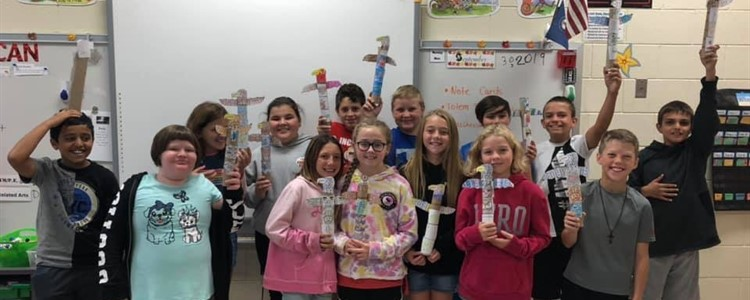 Mrs. Hill's 5th graders and their totem poles!