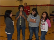 4 girls from Prince of Peace Home for Girls in San Cristobal, Guatemala, tell students about the customs of other countries.