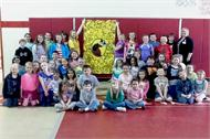 Ms. Patton's Gifted & Talented Students Pose with Derby Blanket