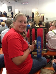 Presley Adkins holds the Horticulture Exhibits Trophy