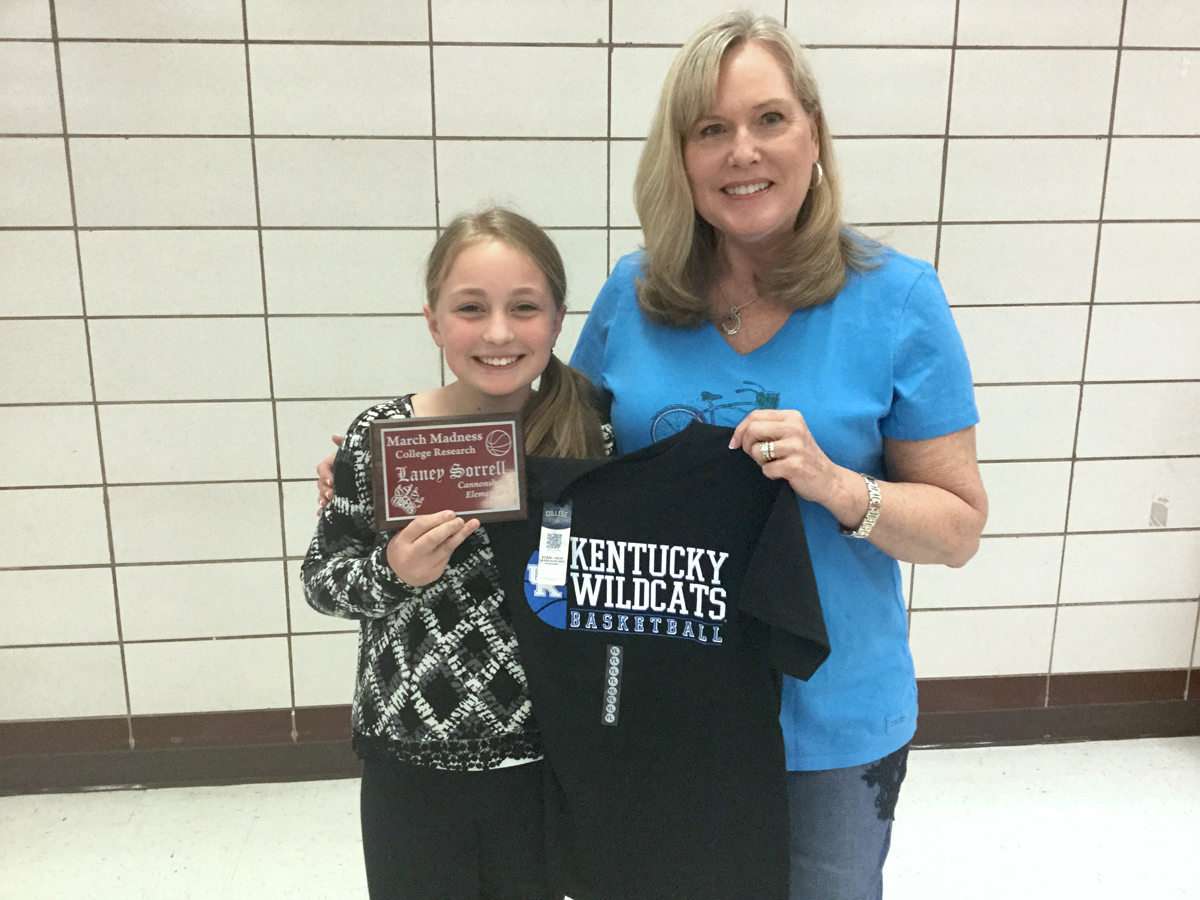 Laney Sorrell, left, and Theresa Kazee pose with Laney's plaque and t-shirt for completing a special College and Career Week assignment.