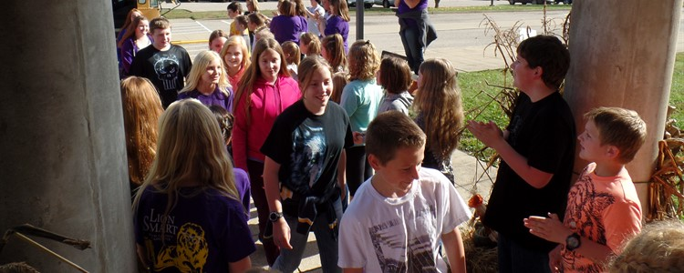 Welcoming the sixth grade students.
