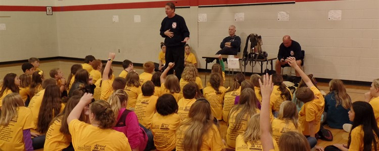 The fire department talking to students on career day.