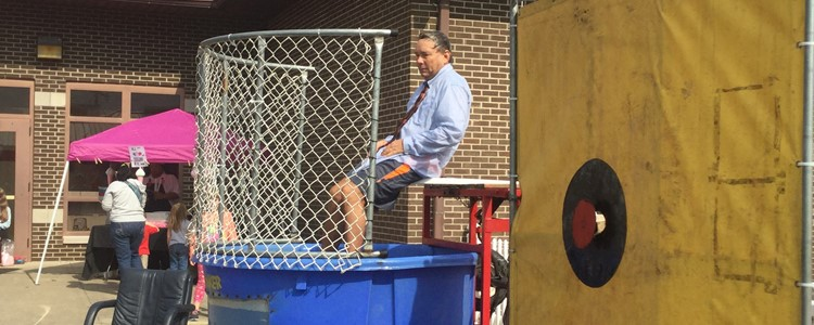 Mr. Stevens in the dunking booth.