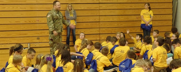 The local National Guard talks to students about military service.