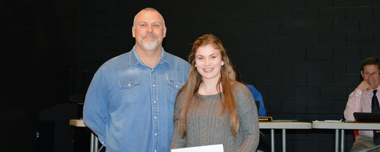 Also recognized at the January BOE meeting was freshman Olivia Hensley who was named the All-Area Girl's Golf Player of the Year. She is pictured here with her coach, and dad, Scott Hensley. She was also named the KYGC Player of the Year.