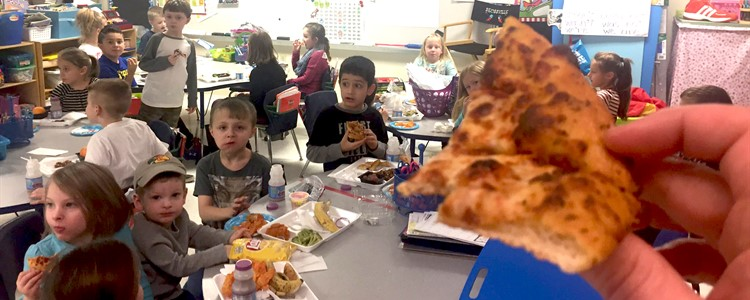 Ms. Deatherage's class enjoying pizza for having 5 straight days of perfect attendance as a class.
