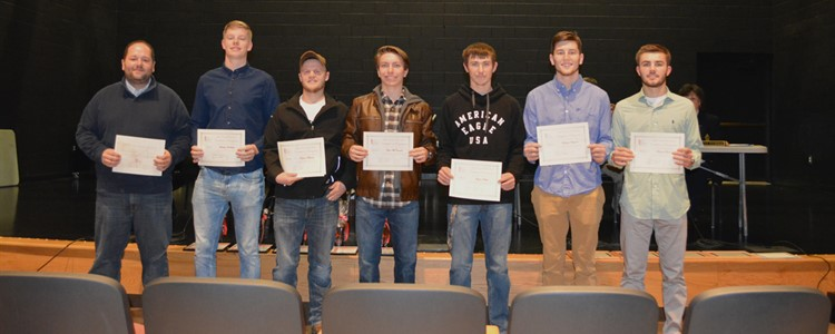 The Boy's All-Area Soccer Team members were recognized by the Board of Education at the January meeting. Pictured, left to right;  Logan Price - Coach, Ludvig Jaderberg, Payton Marcum, Zach McConnell, Logan Suttles, Matthew Ferguson and Tanner Evans. The team set a school record of the most wins in a season. Payton Marcum was selected as the Player of the Year. Both Payton and Tanner Evans have been chosen for the All-Area team two years in a row.