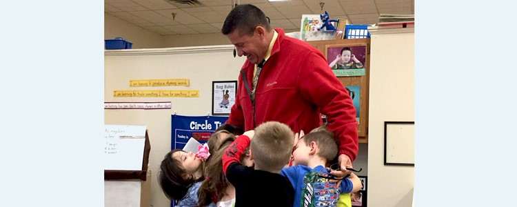 Superintendent Brock Walter gets a mass hug from our preschoolers.
