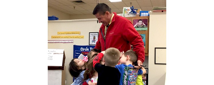 BCPS Superintendent Brock Walter gets a mass hug from our preschool students.