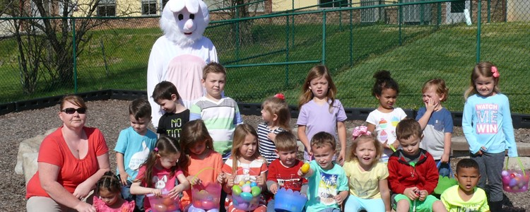 Kindercollege kids pose with EB after a successful egg hunt.