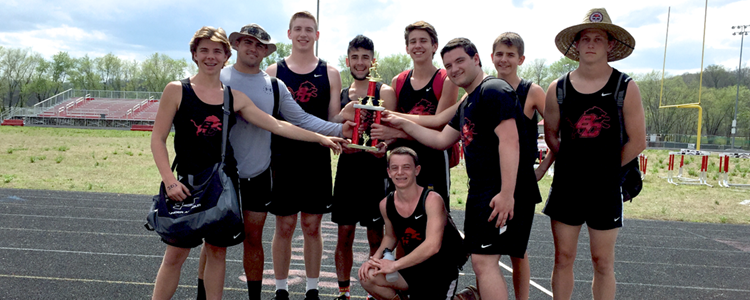 The Boys' Track Team brings home the 1st place trophy in the Rice-Stacey Classic.