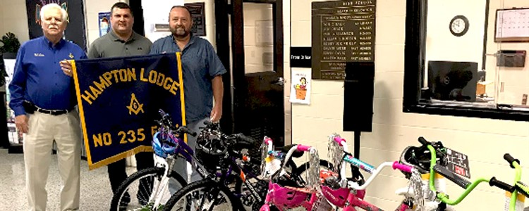 Masonic Lodge 235 representatives pose with the new bikes they have donated as attendance incentives. Thank you, Lodge 235!