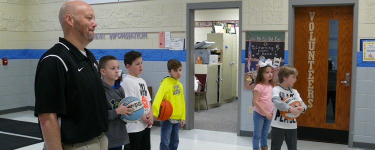 Principal Stewart watches Ms. Wallace's students use movement to exercise both their minds and their bodies. The equipment used was purchased through a grant from AEG.