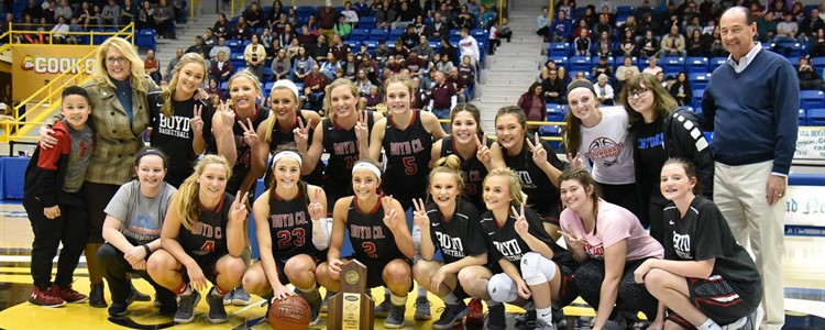 The 16th Region Champs! Boyd County's Lady Lions pose with their trophy, flanked by KY Senator Robin Webb (left) and State Rep. Rocky Adkins (right).