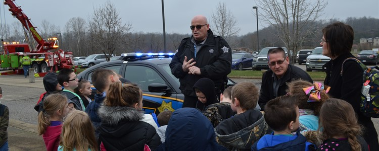 Sheriff's Deputy Tim Wechsler, the BCPS School Resource Officer, talks with students during the Career Fair.