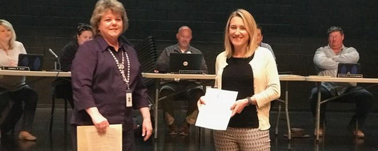 Courtney Martin, at right, is recognized at the Board of Education meeting for her outstanding work as Assistant Principal of Boyd County High. April was National Assistant Principal Recognition month.