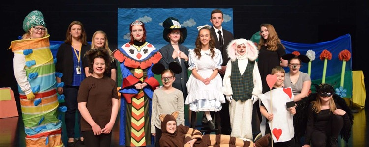The cast of Alice in Wonderland was comprised of Boyd County Schools' students and was performed at the high school's Alumni Auditorium. Ms. Johnson, standing, second from left, was the director.