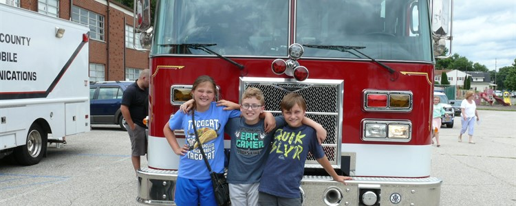 At the 21st Century Wow/Aces Summer Camp, friends gather for a picture in front of Catlettsburg Fire Department's big firetruck.