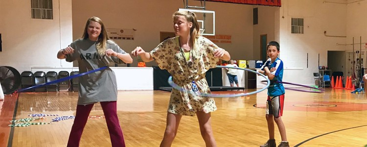 Hoola hooping to stay healthy. Burning calories can be fun! Different activity stations were set up during the Catlettsburg Elementary Food Fun Day event.