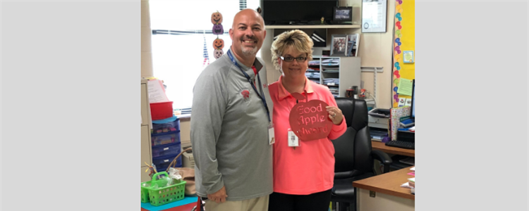 Superintendent Bill Boblett, at left, is pictured with Catlettsburg teacher Kathy Cook, right, who is the first recipient of the Good Apple Award. The award is chosen by the superintendent.