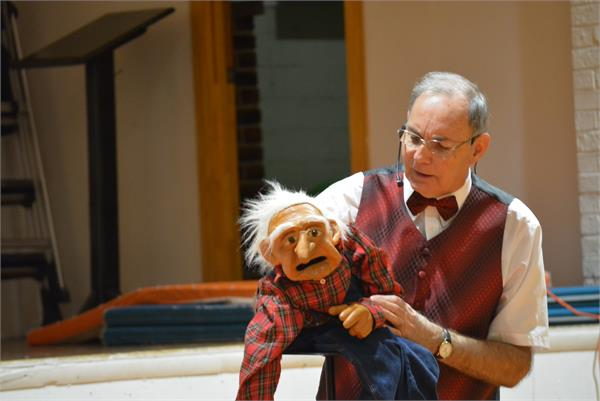 The old man puppet was a huge hit with the students.