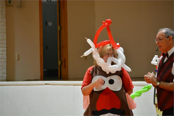 A teacher wears a 'Santa' balloon made just for her.