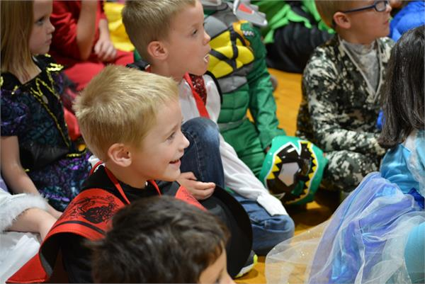 Catlettsburg students enjoy the assembly. Many students are in costume because it is Halloween.