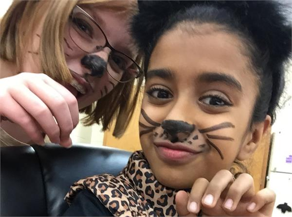 Two students dressed as cats.