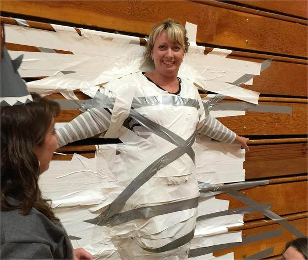 Taping the Assistant Principal to the bleachers!
