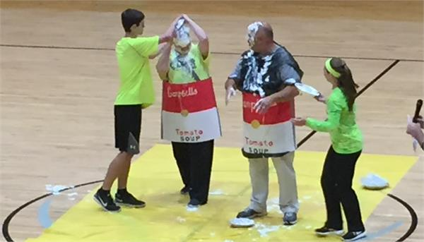 The Principal and Vice Principal take a pie in the face for the team.