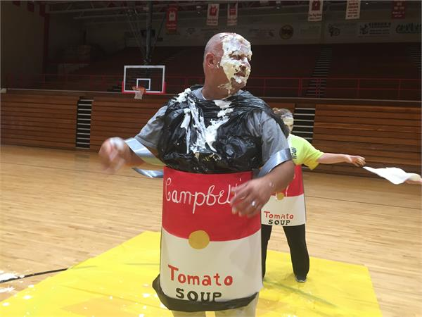 The BCMS Principal takes a pie in the face while dressed as a can of Campbell's Tomato Soup.