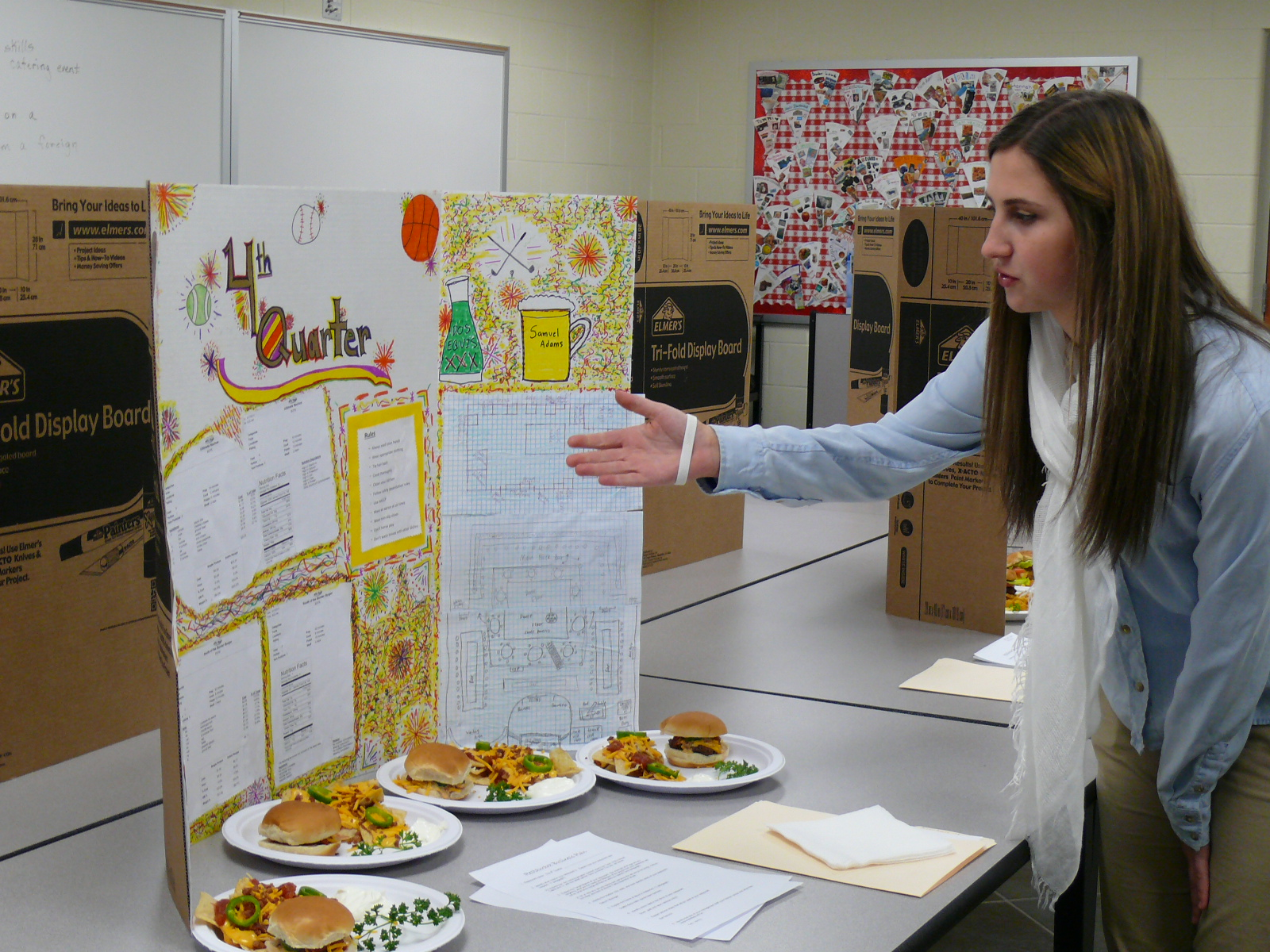 A high school student demonstrates her culinary project.