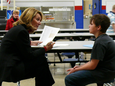 Marilyn Mayo talks with a Middle School Student regarding his test scores