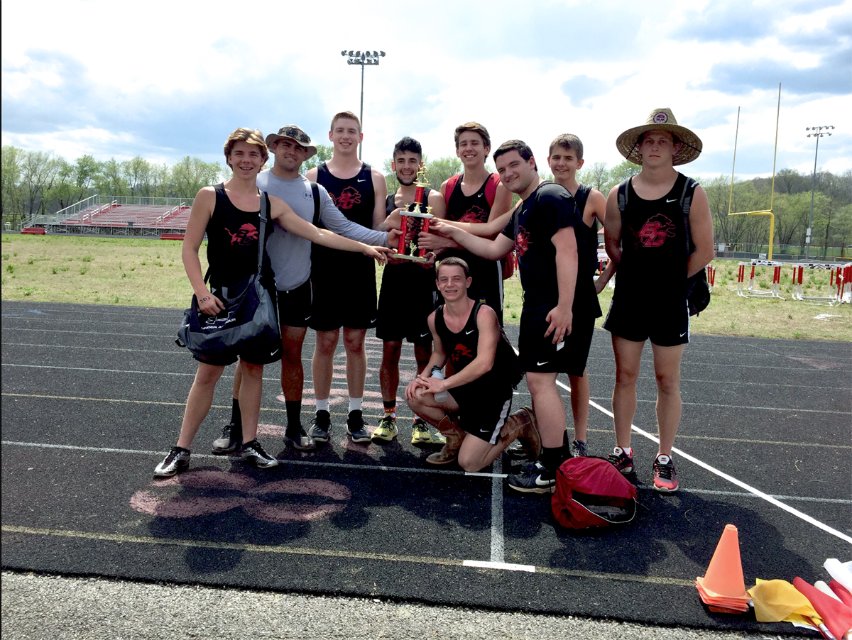 Boyd County Boys' Track Team pose with their 1st place trophy at the Rice-Stacey Classic.