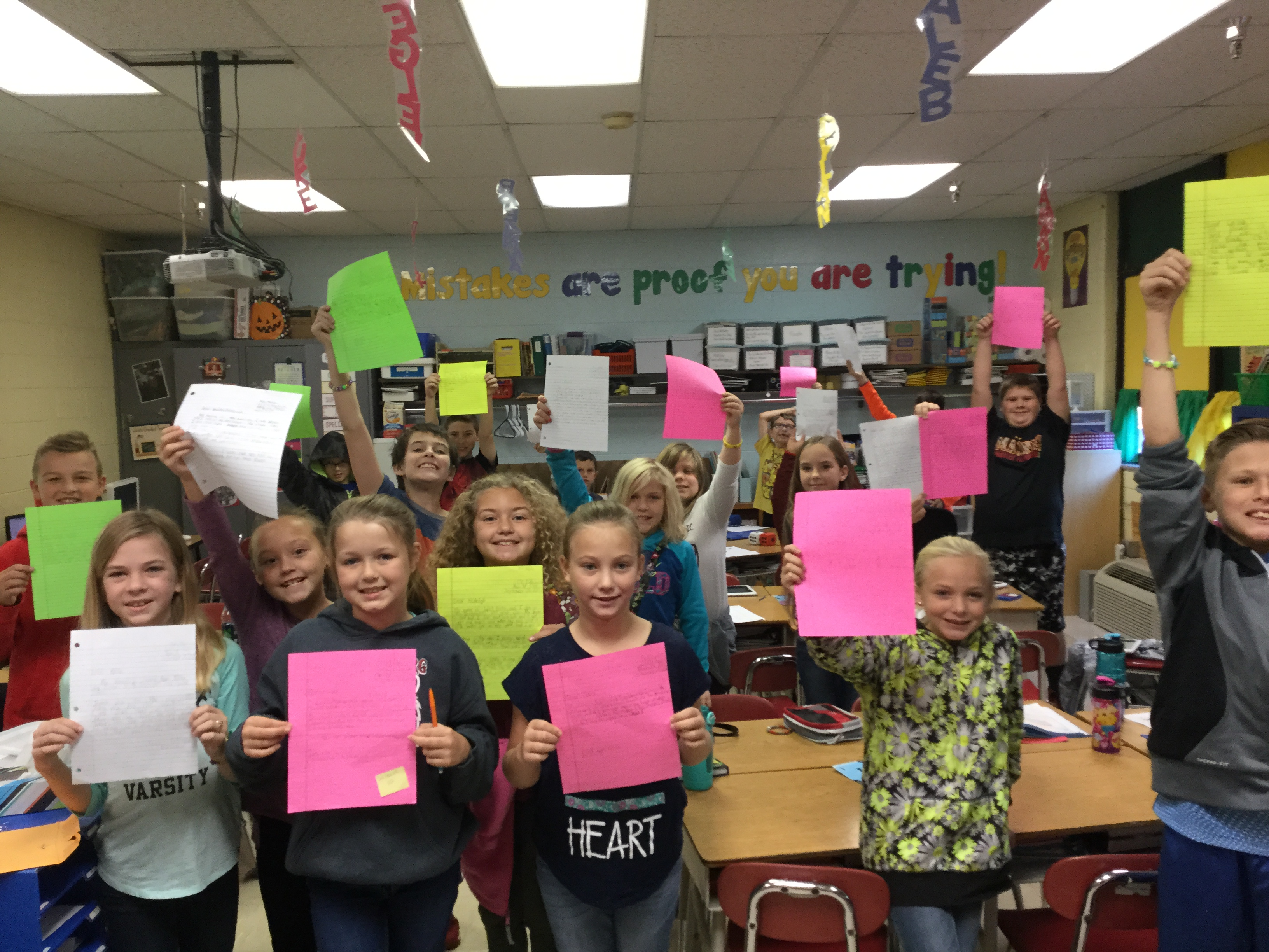 Cannonsburg Elementary students hold up correspondence they received as a thank you from Bill Hasse Elementary School in Alvin, Texas.