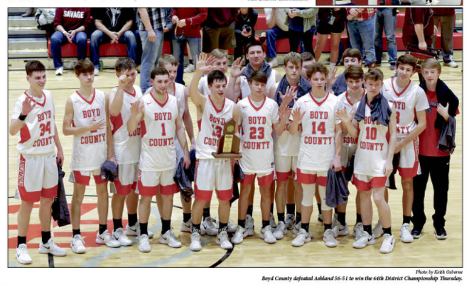 Picture of the BCHS Boys Basketball Team who won the 64th District Championship for the 5th straight year.